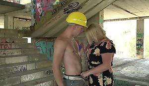 Beamy blonde mature with big tits fucks young builder