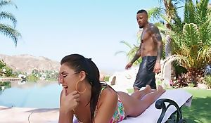 Young brunette pleasuring handsome black pauper by the pool
