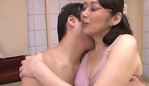 Japanese housewife with glasses receives fucked balls deep