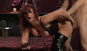 Passionate redhead slut in high boots gets fucked unchanging