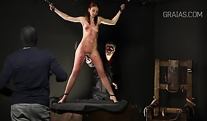 Slim lady is come by BDSM and likes to get flogged very hard, while promised tight