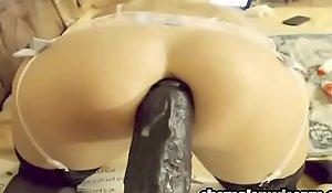 Powered shemale rams huge black dildo with respect relative to her bore