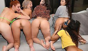 6 elegant girls having fun encircling the living room
