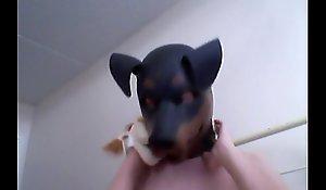 Kinky Girl gets off wearing a rubber dog bedim