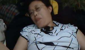 Chinese granny fucks near the wild