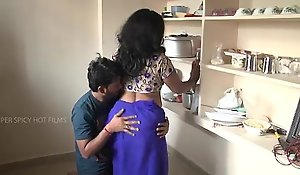 Indian progenitrix and son liaison thither kitchen
